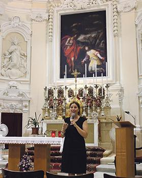 Christine Muscat delivering a talk in the restored Magdalene Church, Valletta.