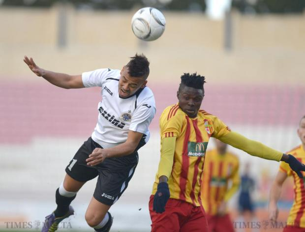 Hibernians' Luis Edison (left) beats Birkirkara's Shola Haruna to the ball during their Premier League match at the National Stadium in Ta'Qali on January 24. Photo: Matthew Mirabelli