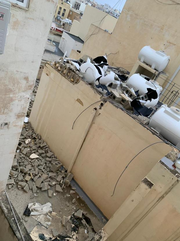 Tanks damaged by a falling wall in Tower Road, Sliema. Photo: Thomas Agius Vadala