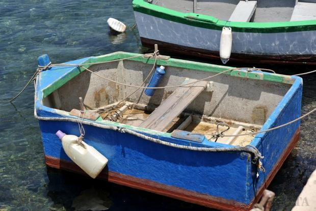 A tiny homemade boat is equipped with plastic bottles to prevent it getting scratched in Bugibba on June 26. Photo: Chris Sant Fournier