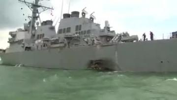 Navy divers find human remains as search for missing sailors continues