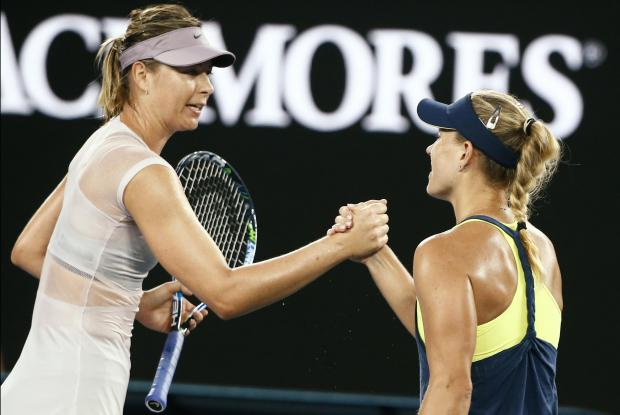 Angelique Kerber of Germany shakes hands with Maria Sharapova of Russia after Kerber won their match.