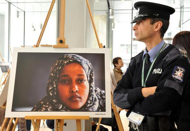 A policeman stands guard at the opening of the European Parliament exhibition paying tribute to female refugees at the Malta Parliament on March 6. Photo: Chris Sant Fournier