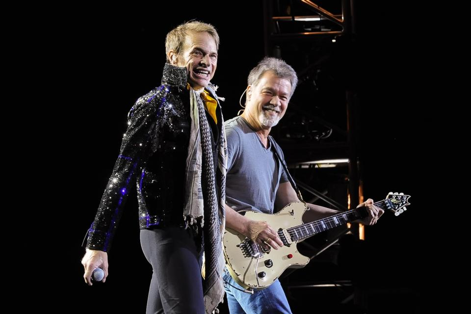 David Lee Roth (left) and Eddie Van Halen performing in a band reunion concert in 2015. PHOTOS: AFP