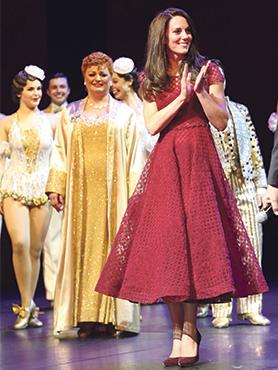 Britain's Duchess of Cambridge on stage during the curtain call on the opening night of the musical 42nd Street, at the Theatre Royal, Drury Lane, London. Photo: Steve Parsons/ Reuters