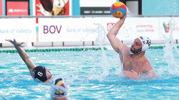 San Ġiljan new recruit Paulo Obradovic attempts a shot on goal as Jordan Camilleri tries to block him during yesterday's President Cup. Photo: Wally Galea
