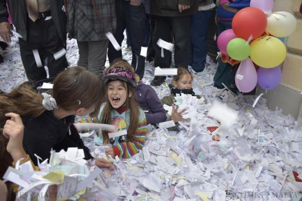 Children play with confetti during the St Paul's Shipwreck feast in Valletta on January 30. Photo Mark Zammit Cordina