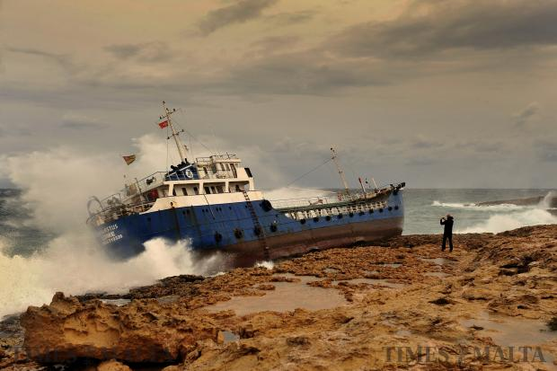 A man photographs the ill-fated tanker The Hephaestus, which ran aground in Qawra after breaking its moorings on February 10. Photo: Chris Sant Fournier
