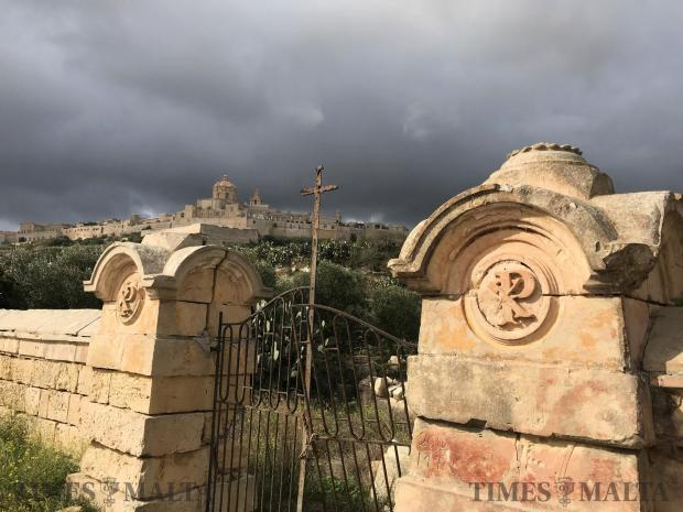 An abandoned cemetery and the Cathedral Church of Mdina engulfed with grey dark clouds on October 28. Photo: Mark Zammit Cordina