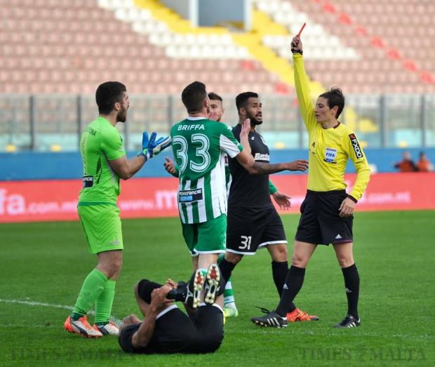 Floriana goalkeeper Matthew Calleja Cremona protests with referee Esther Azzopardi after being shown a straight red card during the Premier League football match against Hibernians at the National Stadium in Ta'Qali on April 3. Photo: Steve Zammit Lupi