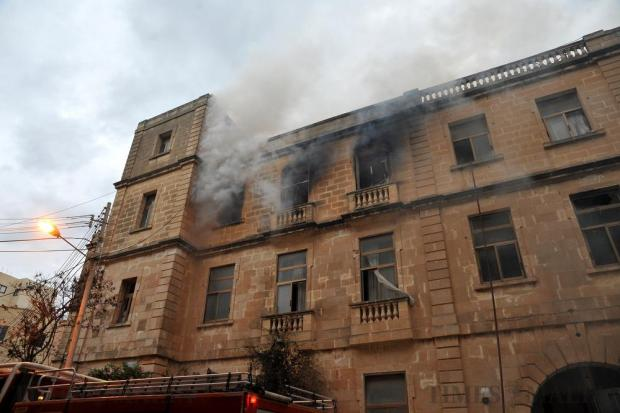 The upper floor of the former Holiday Inn hotel in Sliema is set ablaze in an act of arson on December 12. Photo: Chris Sant Fournier