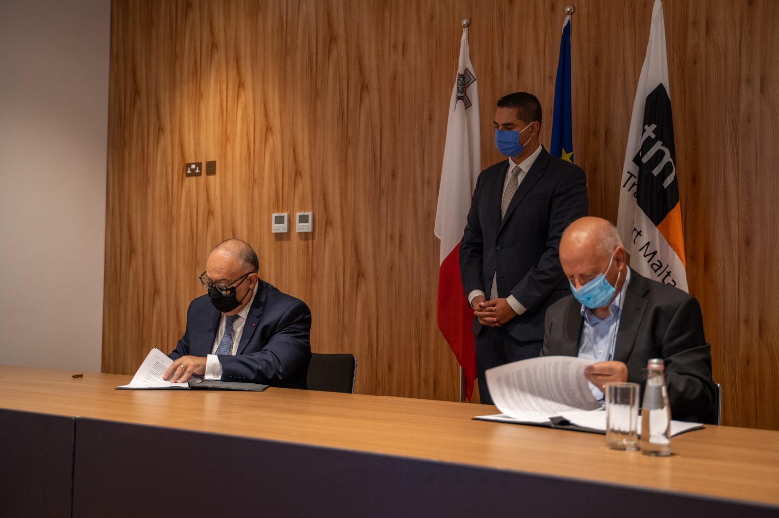Transport Malta chairman Josef Bugeja and University of Malta rector Alfred Vella sign an MOU concerning the fund, as Transport Minister Ian Borg looks on. Photo: Transport Ministry