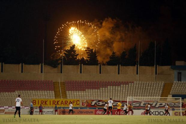 Fireworks over nearby Mosta are seen during the during the Super Cup final between Hibernians and Birkirkara at the National Stadium in Ta'Qali on August 12. Photo: Darrin Zammit Lupi