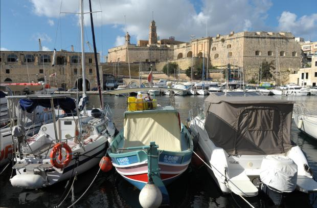 A traditional Maltese fishing boat is sandwiched between two boats at the Grand Harbour Marina on Birgu on January 30. Photo: Matthew Mirabelli