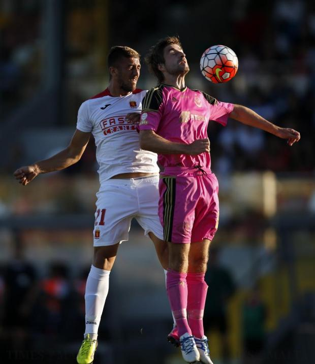 Valletta's Llywelyn Cremona and B36 Torshavn's Roaldur Jakobson (right) jump for a high ball during the first leg of their Champions League first qualifying round football match at the Hibs Stadium in Corradino on June 28. Photo: Darrin Zammit Lupi
