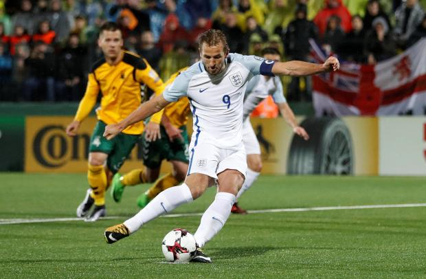 England's Harry Kane scores their first goal from a penalty.