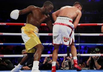 Watch: Crawford stops Khan to retain WBO welterweight title