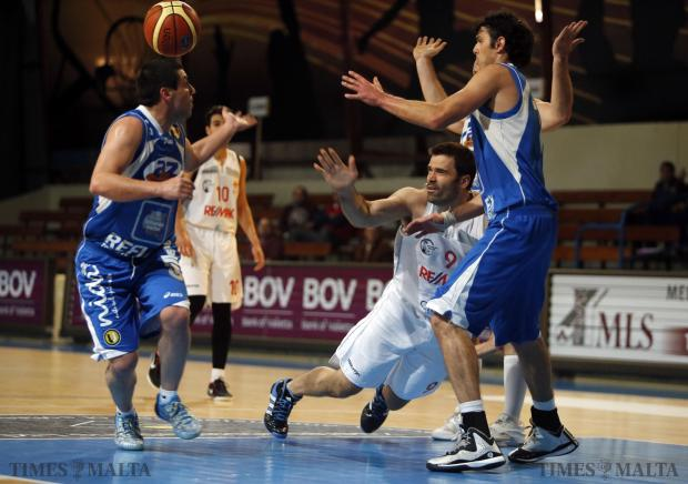 Siggiewi's Marco Matijevic (centre) loses his footing during the basketball match against Athleta at the Ta'Qali Pavilion on January 11. Photo: Darrin Zammit Lupi