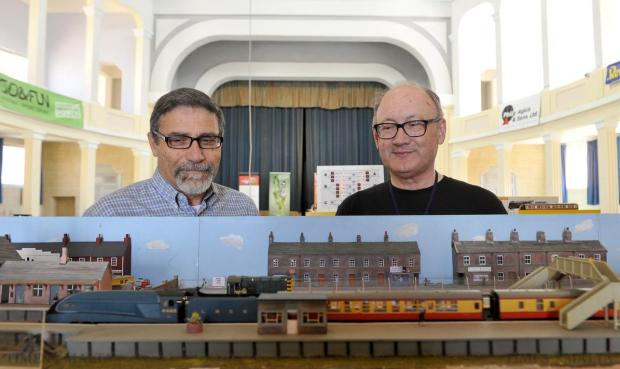 Model makers watch an electric train go by at the Model Engineers exhibition at the Victoria Hall Oratory in Naxxar on April 29. Photo: Chris Sant Fournier