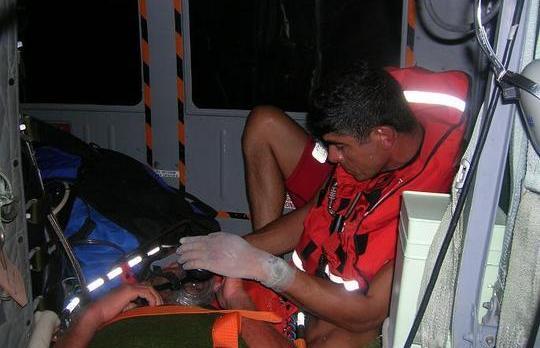 Simon Bugeja being treated on the rescue helicopter.