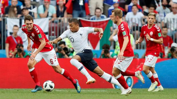 France's Kylian Mbappe in action with Denmark's Andreas Christensen and Christian Eriksen.