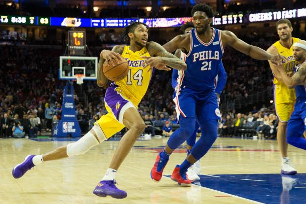 Los Angeles Lakers forward Brandon Ingram (14) dribbles the ball past Philadelphia 76ers center Joel Embiid (21) during the third quarter at Wells Fargo Center. Photo: Bill Streicher-USA TODAY Sports.