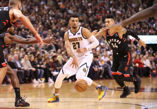 Denver Nuggets guard Jamal Murray (27) dribbles against the Toronto Raptors in the second quarter at Scotiabank Arena. The Nuggets beat the Raptors 106-103. Mandatory Credit: Tom Szczerbowski-USA TODAY Sports