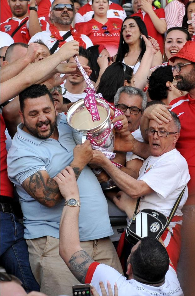 Valletta fans celebrate with their trophy after winning the Premier League on April 21. Photo: Chris Sant Fournier