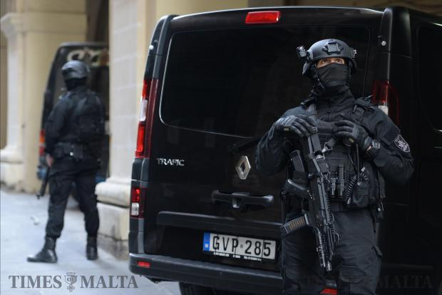 Armed police guard the bank entrance to the courtroom as the suspects in the Daphne Caruana Galizia murder case is heard in the Law Courts in Valletta on December 19. Photo: Matthew Mirabelli