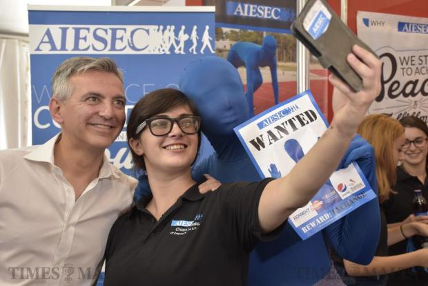 A student takes a photo with Opposition Leader Simon Busuttil and a person dressed in blue during Freshers Week at the University of Malta in Tal-Qroqq on October 4. Photo: Mark Zammit Cordina