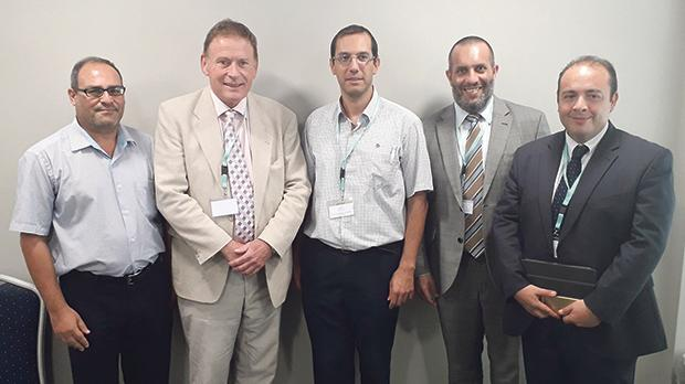 John Acres, president of the Royal Town Planning Institute of the UK (second from left), with the Malta Chamber of Planners.