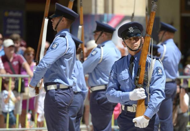 A member of the Malta Police Precision Drill team performs outside Parliament in Valletta on July 4, to celebrate the Police Forces 202nd Anniversary. Photo: Matthew Mirabelli