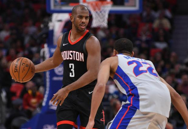 Houston Rockets guard Chris Paul (3) brings the ball up court as Detroit Pistons guard Avery Bradley (22) defends during the second quarter at Little Caesars Arena. Photo: Tim Fuller-USA TODAY Sports