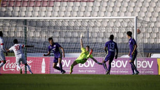Abdelkarim Nafti (left) scores Valletta's opening goal against St Andrew's during their Premier League football match at the National Stadium in Ta' Qali on February 21. Photo: Darrin Zammit Lupi