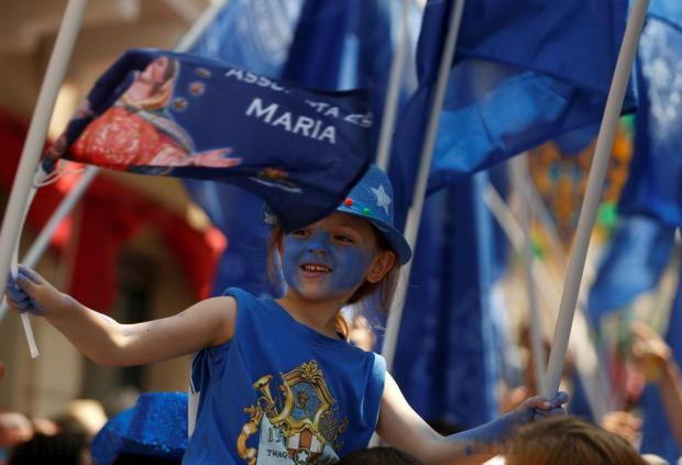 A child takes part in a village band march during celebrations marking the feast of the Assumption of Our Lady in Mosta on August 15. Photo: Darrin Zammit Lupi