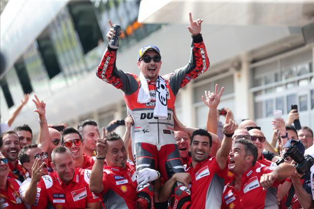 2018 Ducati Team's Jorge Lorenzo celebrates with his team after winning the race.