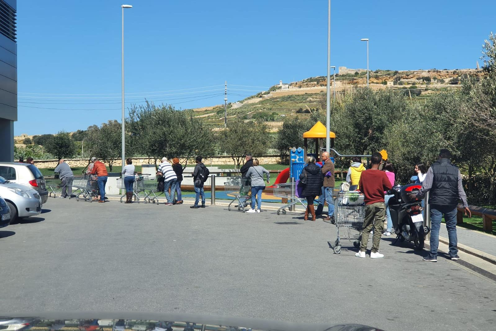 Queues forming outside a Lidl store in Gozo on Saturday.