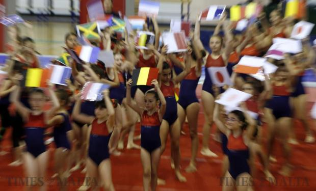 Gymnasts take part in the closing ceremony of the Malta Gymnastics Club's annual event, Gymfest, at the University Sports Complex in Tal-Qroqq on June 5. Some 500 gymnasts, aged between 5 and 16, from 12 schools participated in the event, showcasing their physical abilities with their performances. Picture taken with zoom burst. Photo: Darrin Zammit Lupi