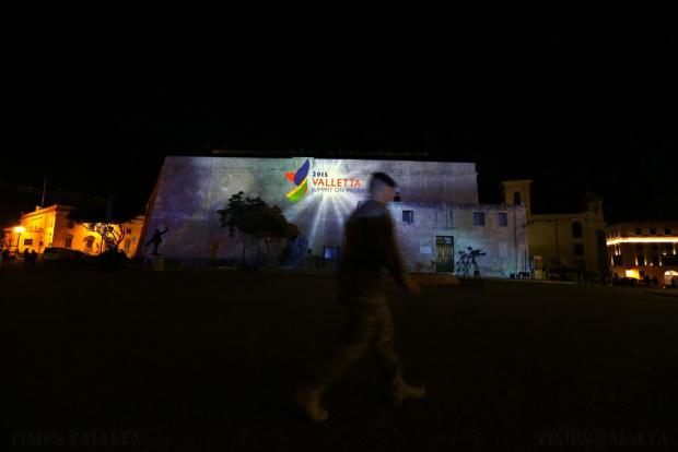 A soldier walks past projections on the facade of St James Cavalier during a rehearsal of the opening ceremony of the 2015 Valletta Summit on Migration in Valletta on November 10. Photo: Darrin Zammit Lupi