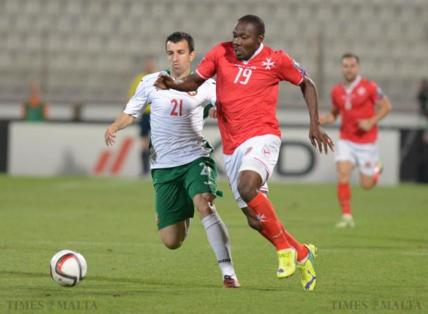 Malta's Alfred Effiong (right) tries to beat Bulgaria's Svetoslav Dyakov during their 2016 UEFA European Championship qualifying match at the National Stadium in Ta'Qali on June 12. Photo: Matthew Mirabelli