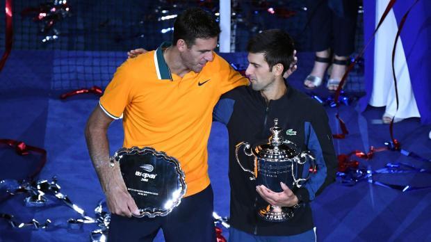 Juan Martin Del Potro (left) talks with Novak Djokovic at the presentation ceremony at the US Open.