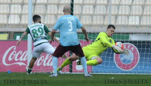 Gżira goalkeeper Jurgen Borg effects a save as Floriana striker Mario Fontanella and Ian Azzopardi, of Gzira, look on at the National Stadium in Ta' Qali on January 29. Photo: Matthew Mirabelli