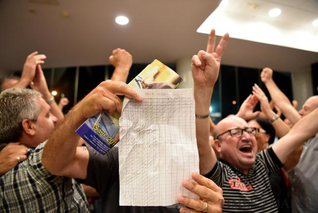 A counting agent for PN Leader Candidate Adrian Delia shows the camera is calculations, moments after the result came out that Adrian Delia had received a large majority of votes from the first round on September 02. Photo: Mark Zammit Cordina