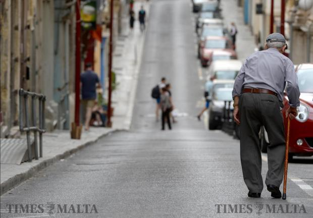 An elderly man makes his way down St Paul Street in Valletta on June 1. Photo: Matthew Mirabelli