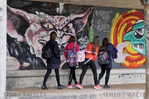 Four girls walk by a graffiti mural in Qui-Si-Sana in Sliema on February 17. Photo: Chris Sant Fournier