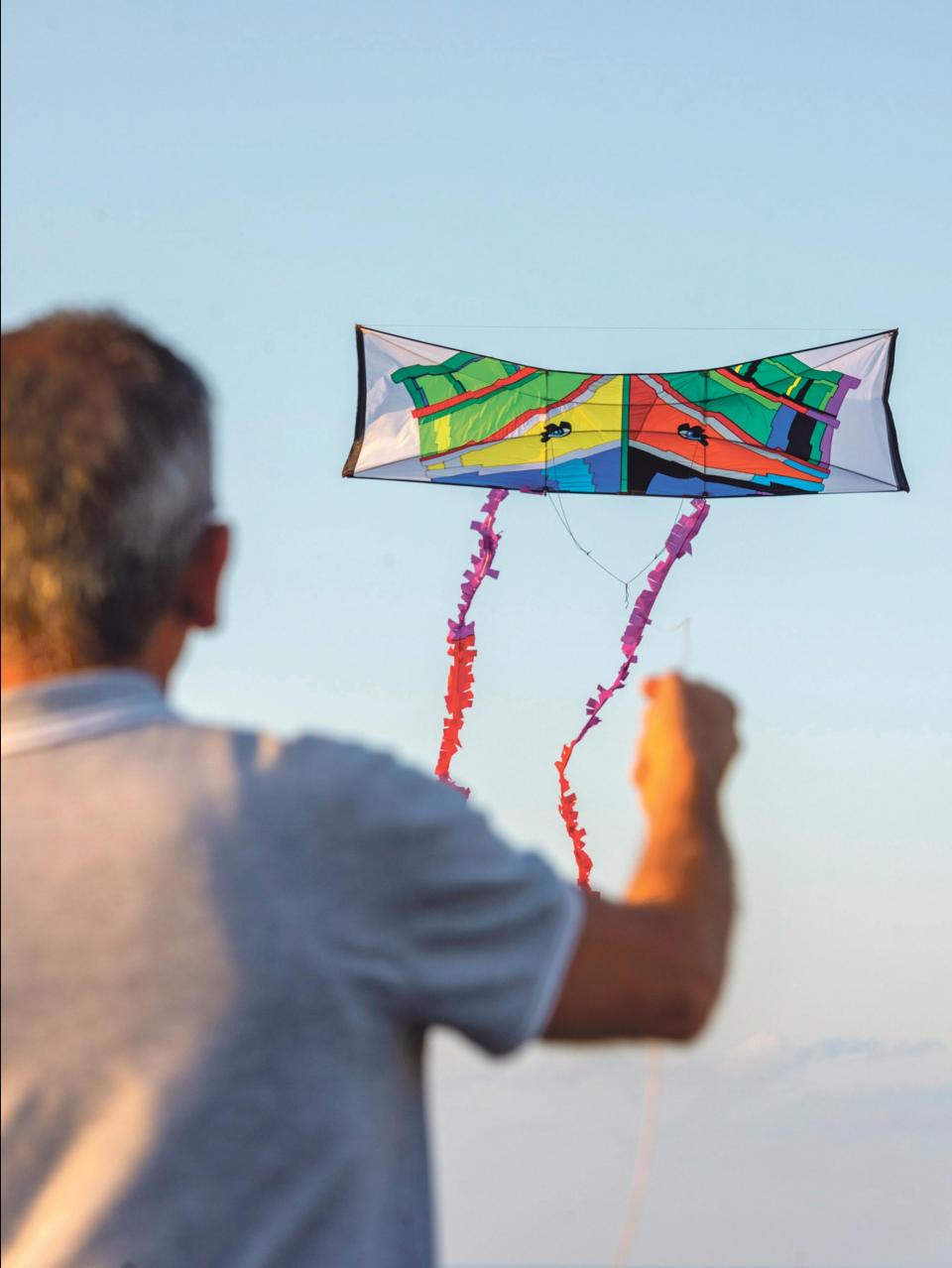 A local enthusiast flying a kite depicting a Maltese luzzu.
