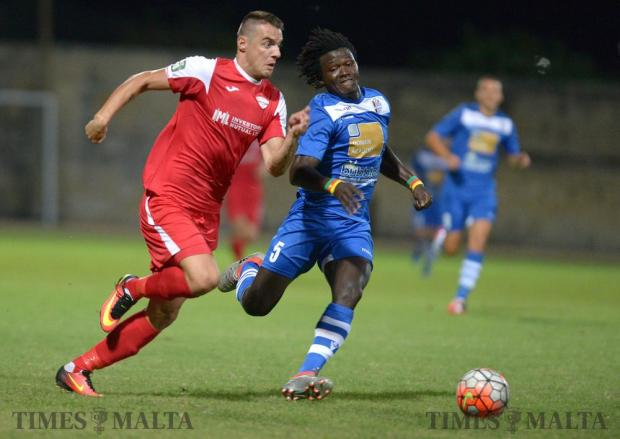 Balzan's Bojan Kaljevic makes his way past Mosta's Dany Djoufack during their Premiership match at the Hibernians Stadium in Corradino on August 20. Photo: Matthew Mirabelli