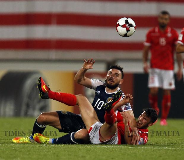 Scotland's Robert Snodgrass tangles with Malta's Luke Gambin during their 2018 World Cup qualifier at the National Stadium in Ta' Qali on September 4. Photo: Darrin Zammit Lupi