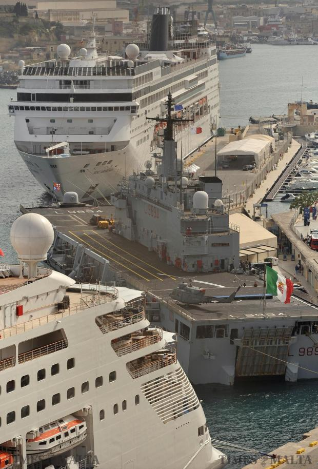 The Italian Navy amphibian assault ship San Giusto is berthed between two cruise liners in Grand harbour on April 26. Photo: Chris Sant Fournier