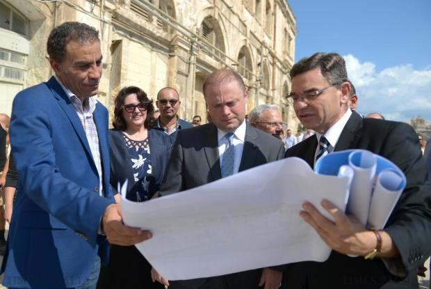 Architect Edwin Mintoff (right) shows the campus plan to Prime Minister Joseph Muscat at Dock 1 in Cospicua on August 21. Photo: Matthew Mirabelli